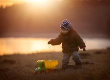 Little boy playing outdoor with a toy car. Royalty Free Stock Photography