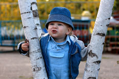 Little boy playing outdoors Stock Photography