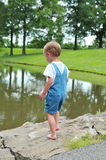 Little Boy playing outdoors Stock Photo