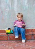 Little boy playing outdoors Stock Photos
