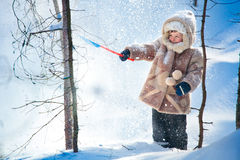 Little boy playing outdoors in a winter fores Royalty Free Stock Images