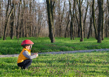 Little boy playing outdoors in woodland Royalty Free Stock Photography