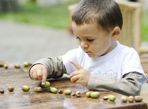 Little boy playing outside Stock Photo