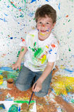 Little boy playing with painting Stock Image