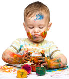 Little boy is playing with paints Stock Photo