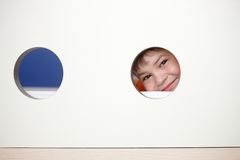 Little boy playing peek-a-boo smiling Royalty Free Stock Photo