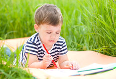 Little boy is playing with pencils Royalty Free Stock Photo