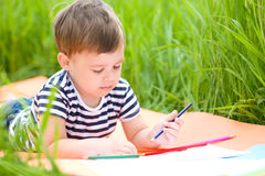 Little boy is playing with pencils Stock Photography