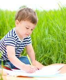 Little boy is playing with pencils Stock Photo