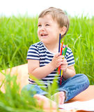 Little boy is playing with pencils Royalty Free Stock Images