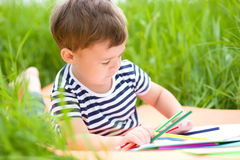 Little boy is playing with pencils Royalty Free Stock Photography