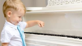 Little boy playing the piano Royalty Free Stock Images