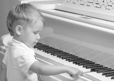Little boy playing the piano Royalty Free Stock Image