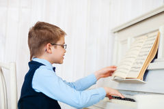 Little boy playing piano at home Royalty Free Stock Images
