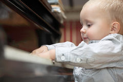 Little boy playing piano indoor Stock Photo