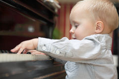 Little boy playing piano indoor Royalty Free Stock Photos