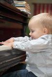 Little boy playing piano indoor Stock Photos