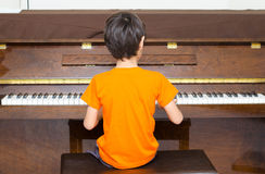Little boy playing piano learning Stock Image