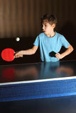 Little boy playing ping pong Stock Image