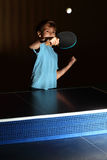Little boy playing ping pong Stock Photo