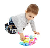 Little boy playing with plasticine. Happy caucasian toddler boy playing with clay dough, isolated on white background Royalty Free Stock Photos