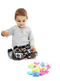 Little boy playing with plasticine. Happy caucasian toddler boy playing with clay dough, isolated on white background Stock Photography