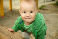 Little boy is playing on playground Royalty Free Stock Image