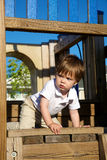 Little boy playing on playground Stock Photography