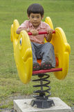 Little boy playing on playground Stock Images