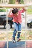 Little boy playing at playground climbing stock image