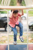 Little boy playing at playground climbing stock images