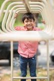 Little boy playing at playground climbing stock photo