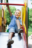 Little boy playing on a playground Royalty Free Stock Photos