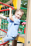Little boy playing on a playground Stock Photo