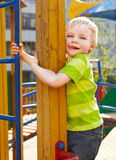 Little boy is playing on playground Stock Images