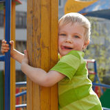 Little boy is playing on playground Stock Photos