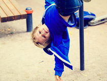 Little boy playing on playground outdoors Royalty Free Stock Images