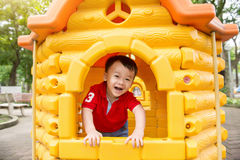 Little Boy Playing At Playhouse Royalty Free Stock Image