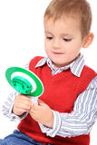 Little boy playing with police signalling disc Stock Photo