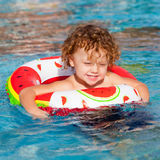 Little boy playing in the pool Stock Image