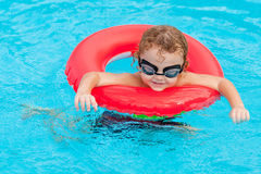 Little boy playing in the pool Royalty Free Stock Images