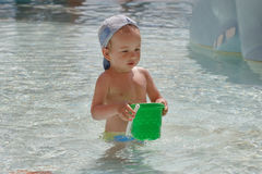 Little boy playing in the pool Royalty Free Stock Photo