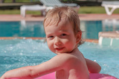 Little boy playing in the pool Stock Images