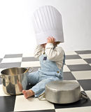 Little boy playing with pots. Little boy druming playing with pots and chef's hat Stock Photography