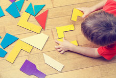 Little boy playing with puzzle, early education Royalty Free Stock Photography