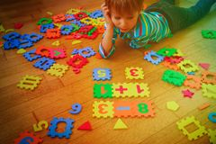 Little boy playing with puzzle, education concept. Little boy playing with puzzle, education and learning concept Stock Images