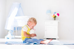 Little boy playing with rabbit pet Royalty Free Stock Photos
