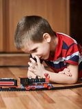 Little boy playing with railway and pick your nose Stock Image