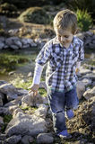 Little boy playing at the river Royalty Free Stock Photo
