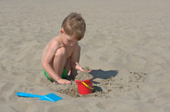 Little boy. Playing with sand Royalty Free Stock Photo
